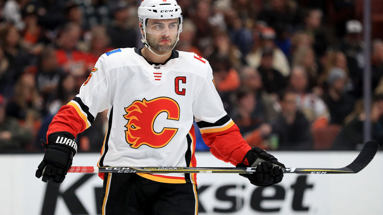ANAHEIM, CA - DECEMBER 29: Mark Giordano #5 of the Calgary Flames looks on during the first period of a game against the Anaheim Ducks at Honda Center on December 29, 2017 in Anaheim, California.