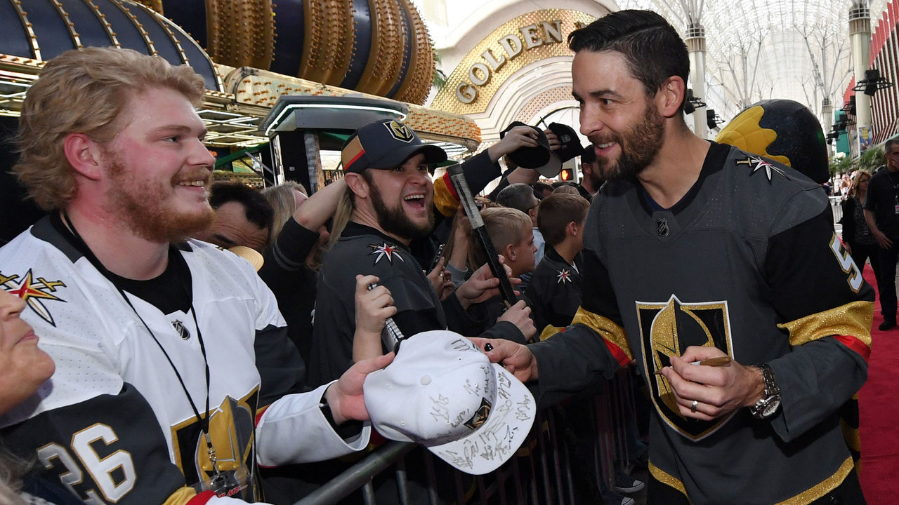 LAS VEGAS, NV - JANUARY 14: Deryk Engelland #5 of the Vegas Golden Knights signs autographs for fans as he walks a red carpet at the Vegas Golden Knights Fan Fest at the Fremont Street Experience on January 14, 2018 in Las Vegas, Nevada.