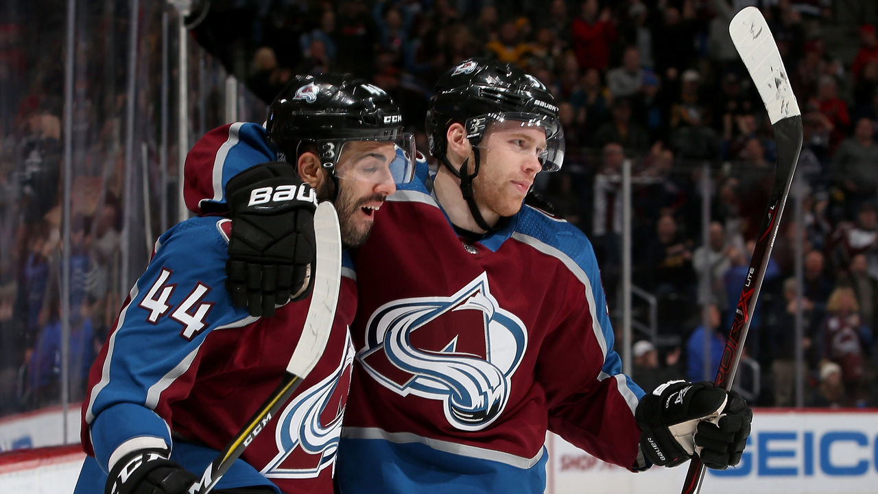 DENVER, CO - DECEMBER 18: Mark Barberio #44 and J.T. Compher #37 of the Colorado Avalanche celebrates Compher's goal against the Pittsburgh Penguins at the Pepsi Center on December 18, 2017 in Denver, Colorado.