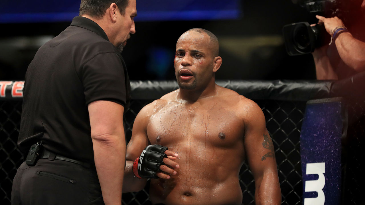 ANAHEIM, CA - JULY 29: Daniel Cormier is checked by referee John McCarthy after receiving an accidental headbutt from opponent Jon Jones (not pictured during the UFC 214 event at Honda Center on July 29, 2017 in Anaheim, California.