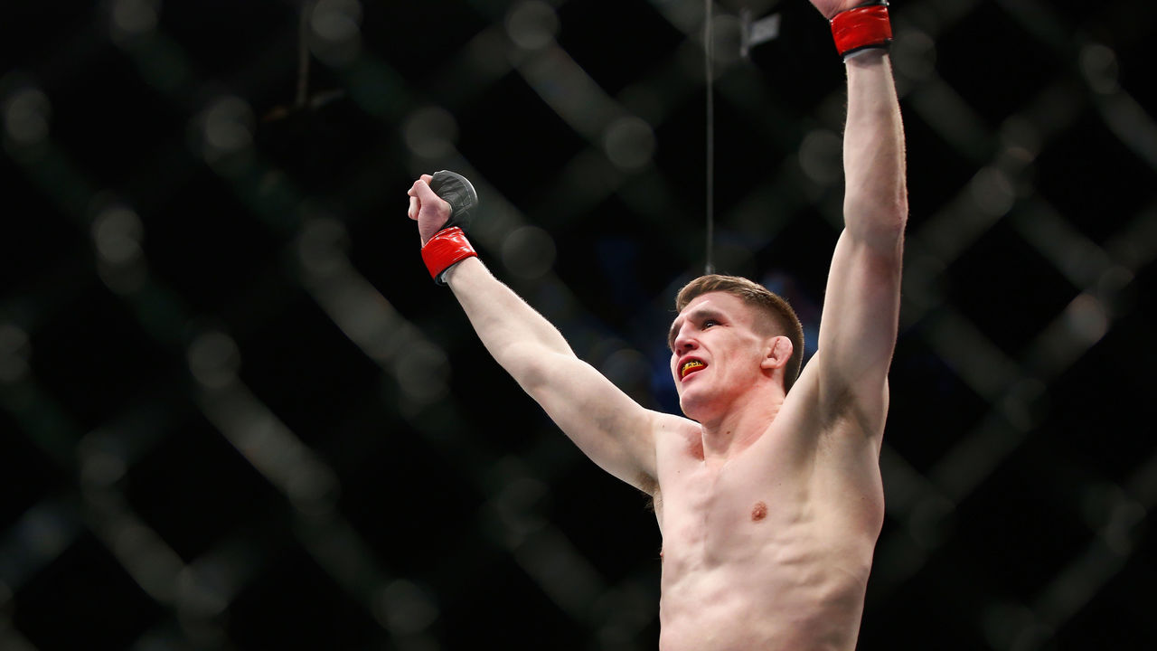 LONDON, ENGLAND - FEBRUARY 27: Scott Askham of England celebrates his knock out victory over Chris Dempsey of USA during the Middleweight Bout of the UFC Fight Night at The O2 Arena on February 27, 2016 in London, England.