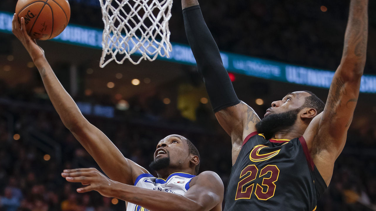 CLEVELAND, OH - JANUARY 15: Kevin Durant #35 of the Golden State Warriors shoots the ball against LeBron James #23 of the Cleveland Cavaliers at Quicken Loans Arena on January 15, 2018 in Cleveland, Ohio.