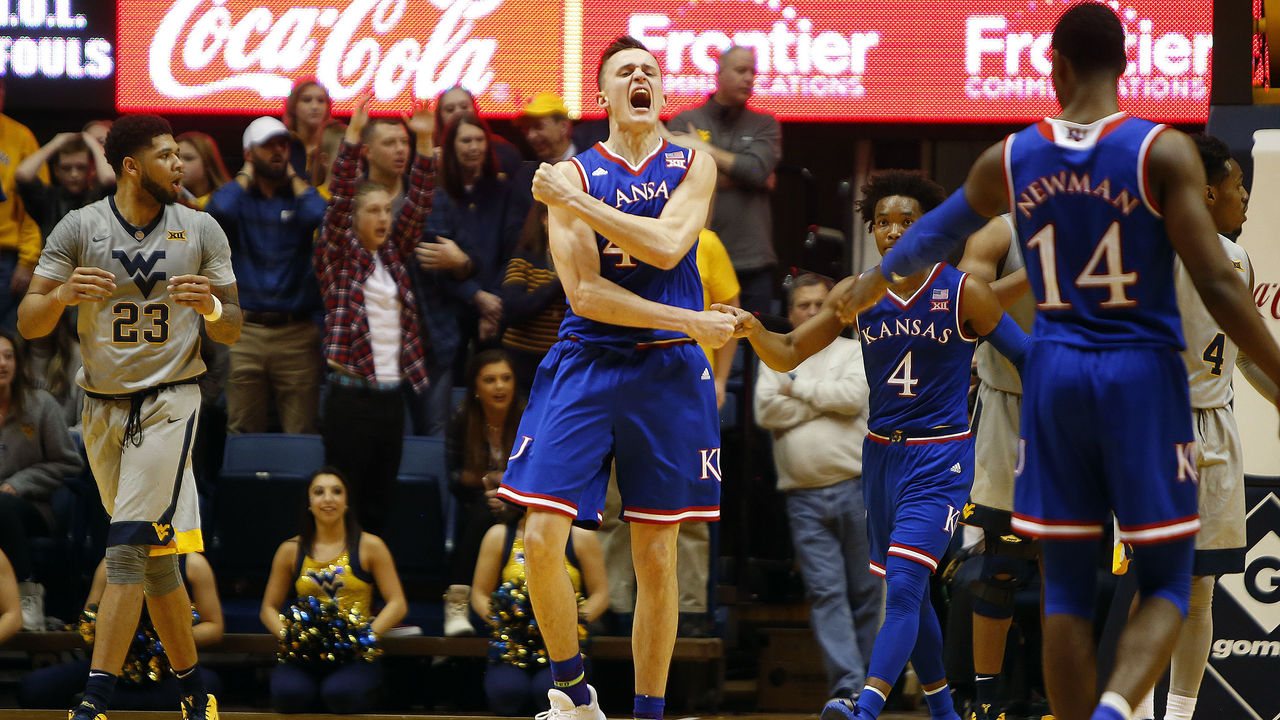 MORGANTOWN, WV - JANUARY 15: Mitch Lightfoot #44 of the Kansas Jayhawks reacts after dunking on Sagaba Konate #50 of the West Virginia Mountaineers (not pictured) putting Kansas up 69-66 at the WVU Coliseum on January 15, 2018 in Morgantown, West Virginia.