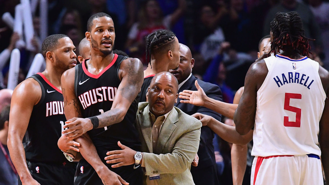 LOS ANGELES, CA - JANUARY 15: Trevor Ariza #1 of the Houston Rockets is restrained by an assistant coach before his ejection from the game during a 113-102 LA Clippers win at Staples Center on January 15, 2018 in Los Angeles, California.