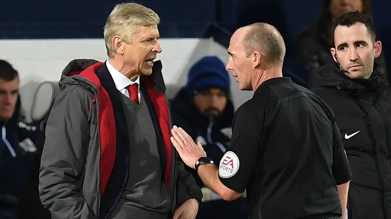 Arsenal's French manager Arsene Wenger (L) has words with English referee Mike Dean during the English Premier League football match between West Bromwich Albion and Arsenal at The Hawthorns stadium in West Bromwich, central England, on December 31, 2017. / AFP PHOTO / Paul ELLIS /