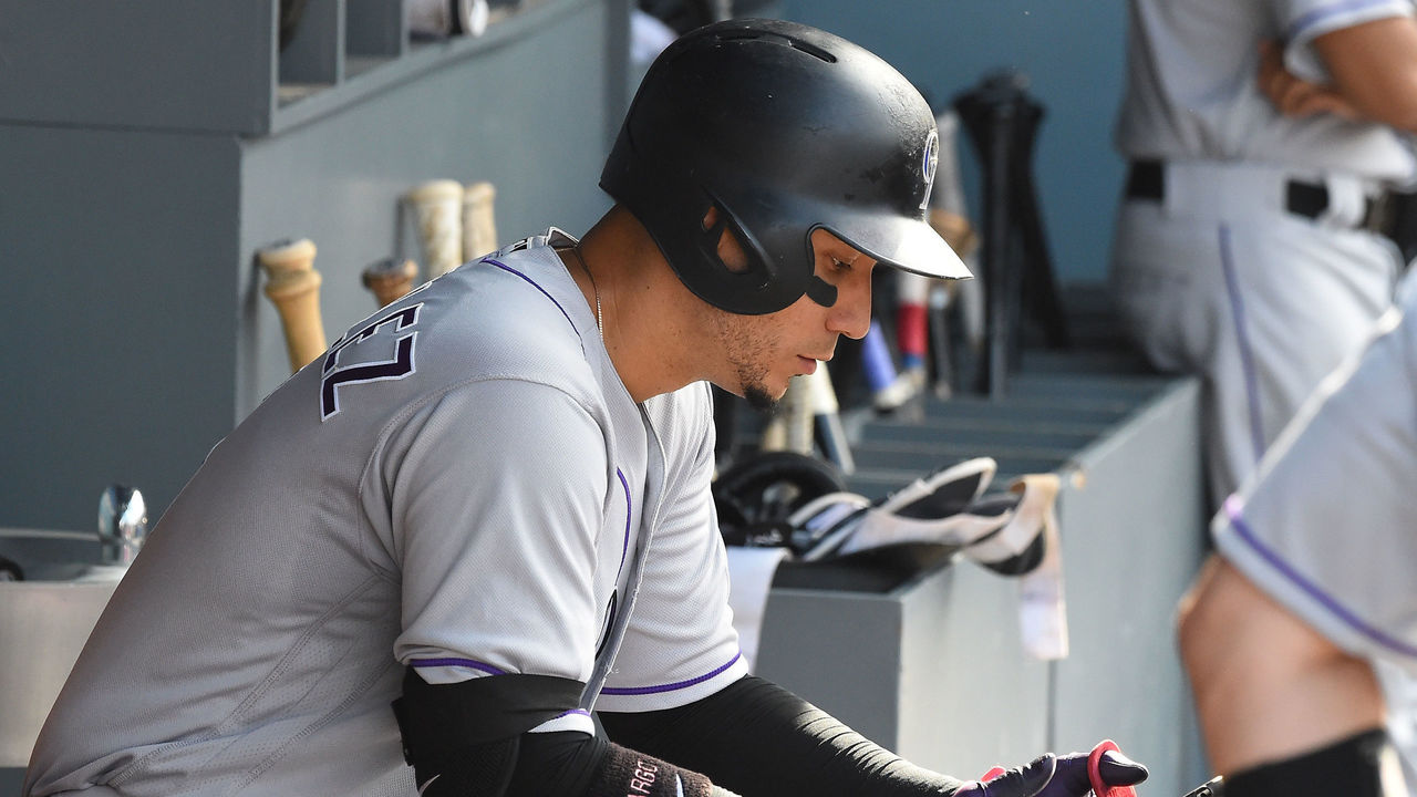 LOS ANGELES, CA - SEPTEMBER 10: Carlos Gonzalez #5 of the Colorado Rockies checks an iPad before going up to bat in the ninth inning of the game against the Los Angeles Dodgers at Dodger Stadium on September 10, 2017 in Los Angeles, California.