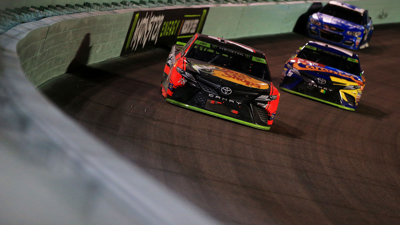HOMESTEAD, FL - NOVEMBER 19: Martin Truex Jr., driver of the #78 Bass Pro Shops/Tracker Boats Toyota, leads Kyle Busch, driver of the #18 M&M's Caramel Toyota, and Kyle Larson, driver of the #42 Credit One/DC Solar Chevrolet, in the final laps of the Monster Energy NASCAR Cup Series Championship Ford EcoBoost 400 at Homestead-Miami Speedway on November 19, 2017 in Homestead, Florida.