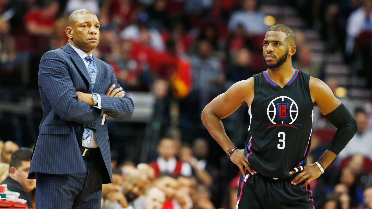 HOUSTON, TX - DECEMBER 19: Head coach Doc Rivers of the Los Angeles Clippers and Chris Paul #3 wait near the bench during their game against the Houston Rockets at Toyota Center on December 19, 2015 in Houston, Texas.
