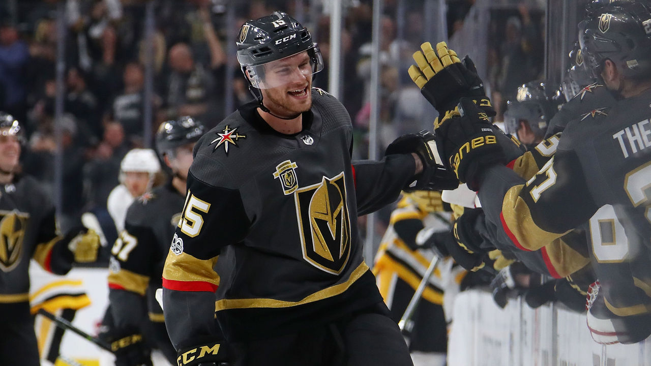 LAS VEGAS, NV - DECEMBER 14: Jon Merrill #15 of the Vegas Golden Knights celebrates his third period goal with teammates while playing the Pittsburgh Penguins at T-Mobile Arena on December 14, 2017 in Las Vegas, Nevada. The Golden Knights won 2-1.