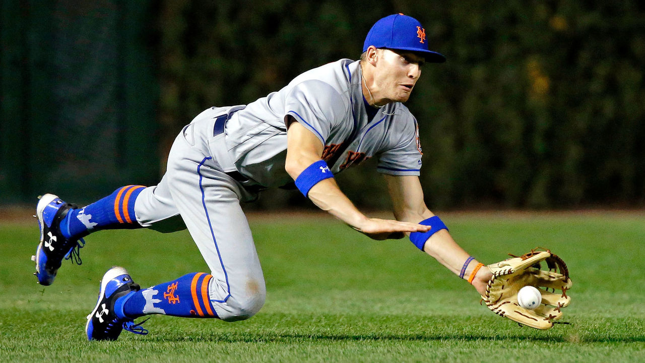 CHICAGO, IL - SEPTEMBER 14: Brandon Nimmo #9 of the New York Mets fields a ball after bouncing in the grass off a hit by Jon Jay #30 of the Chicago Cubs (not pictured) during the sixth inning at Wrigley Field on September 14, 2017 in Chicago, Illinois.