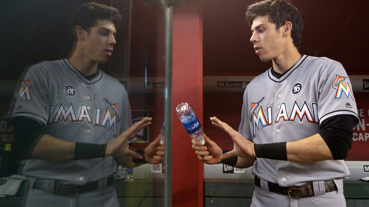 PHOENIX, AZ - SEPTEMBER 24: Christian Yelich #21 of the Miami Marlins walks in the dugout before the MLB game against the Arizona Diamondbacks at Chase Field on September 24, 2017 in Phoenix, Arizona.