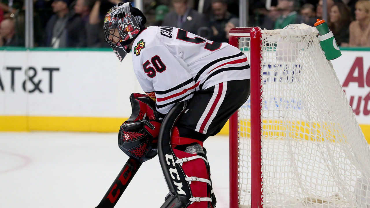 DALLAS, TX - DECEMBER 21: Corey Crawford #50 of the Chicago Blackhawks reacts after giving up a goal against the Dallas Stars in the first period at American Airlines Center on December 21, 2017 in Dallas, Texas.