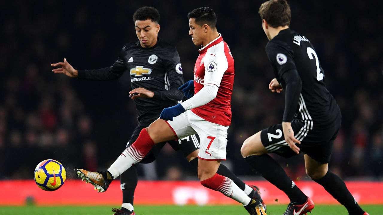 LONDON, ENGLAND - DECEMBER 02: Alexis Sanchez of Arsenal is challenged by Jesse Lingard of Manchester United during the Premier League match between Arsenal and Manchester United at Emirates Stadium on December 2, 2017 in London, England.