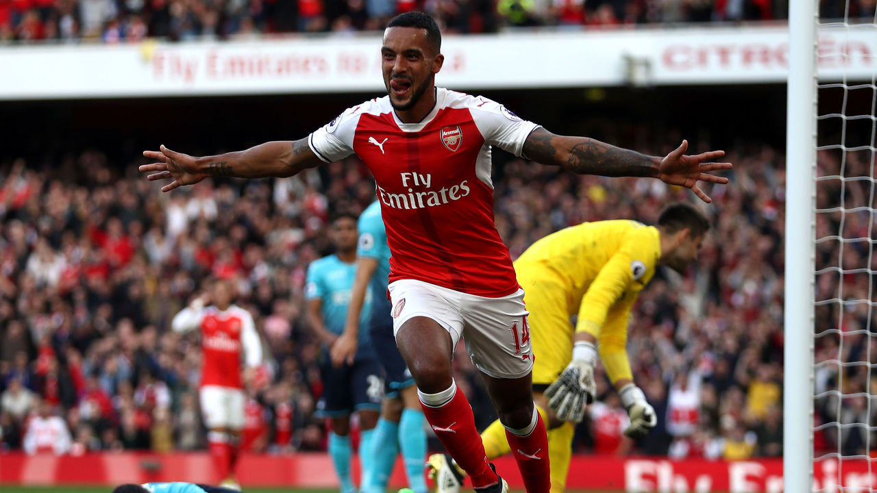 LONDON, ENGLAND - OCTOBER 15: Theo Walcott of Arsenal celebrates scoring his sides first goal during the Premier League match between Arsenal and Swansea City at Emirates Stadium on October 15, 2016 in London, England.