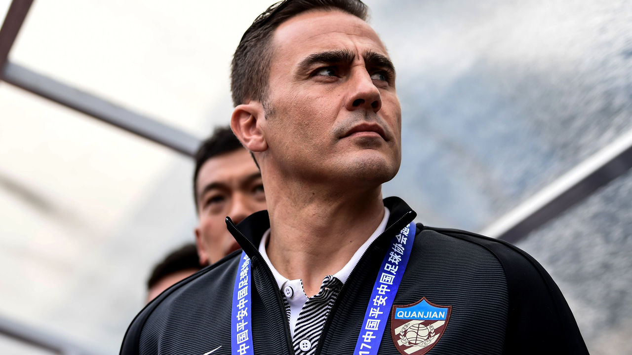 Tianjin Quanjian's head coach Fabio Cannavaro looks on before the Chinese Super League match against Guangzhou R&F in Guangzhou, south China's Guangdong province on March 4, 2017. / AFP PHOTO / STR / CHINA OUT