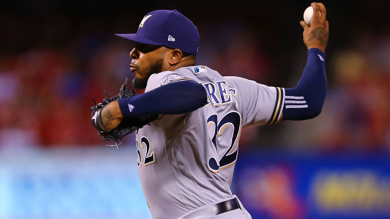 ST. LOUIS, MO - SEPTEMBER 29: Jeremy Jeffress #32 of the Milwaukee Brewers delivers a pitch against the St. Louis Cardinals in the eighth inning at Busch Stadium on September 29, 2017 in St. Louis, Missouri.