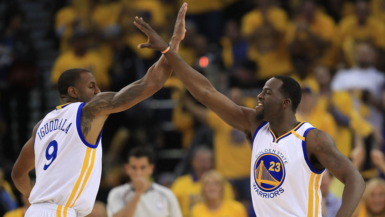 OAKLAND, CA - MAY 04: Draymond Green #23 of the Golden State Warriors reacts with Andre Iguodala #9 after hitting a three-point basket against the Utah Jazz during Game Two of the NBA Western Conference Semi-Finals at ORACLE Arena on May 4, 2017 in Oakland, California.
