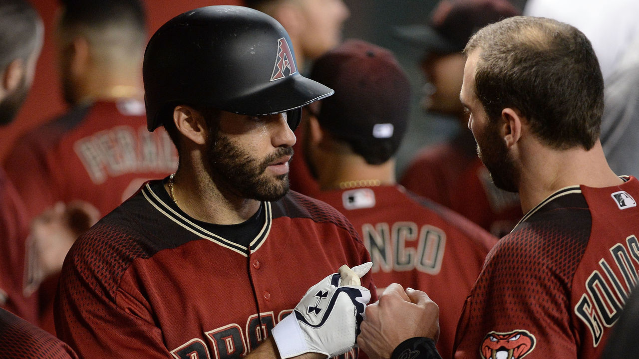 PHOENIX, AZ - SEPTEMBER 10: J.D. Martinez #28 of the Arizona Diamondbacks is congratulated by Paul Goldschmidt #44 after hitting a solo home run in the sixth inning against the San Diego Padres at Chase Field on September 10, 2017 in Phoenix, Arizona.