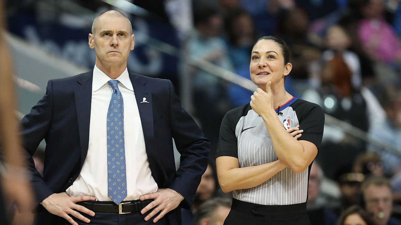 DALLAS, TX - NOVEMBER 29: (L-R) Head coach Rick Carlisle of the Dallas Mavericks and NBA referee Lauren Holtkamp #7 in the first half of play between the Dallas Mavericks and the Brooklyn Nets at American Airlines Center on November 29, 2017 in Dallas, Texas.