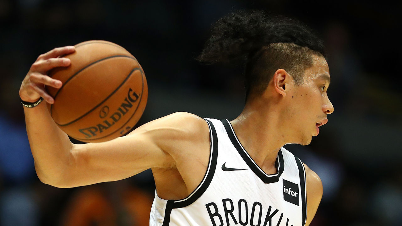 UNIONDALE, NY - OCTOBER 11: Jeremy Lin #7 of the Brooklyn Nets dribbles against the Philadelphia 76ers during their Pre Season game at Nassau Veterans Memorial Coliseum on October 11, 2017 in Uniondale, New York. NOTE TO USER: User expressly acknowledges and agrees that, by downloading and/or using this Photograph, user is consenting to the terms and conditions of the Getty Images License Agreement.
