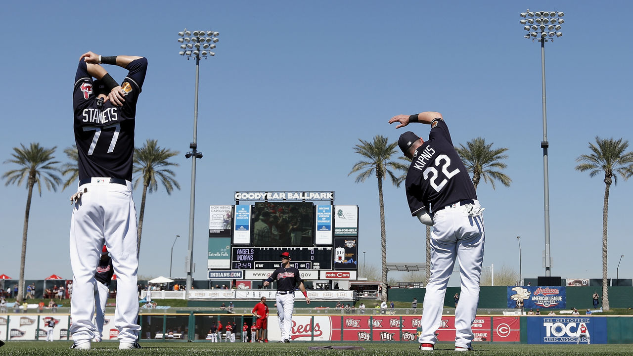 GOODYEAR, AZ - MARCH 09: Jason Kipnis #22 of the Cleveland Indians and Eric Stamets #77 stretch out before the spring training game against the Los Angeles Angels of Anaheim at Goodyear Ballpark on March 9, 2017 in Goodyear, Arizona.