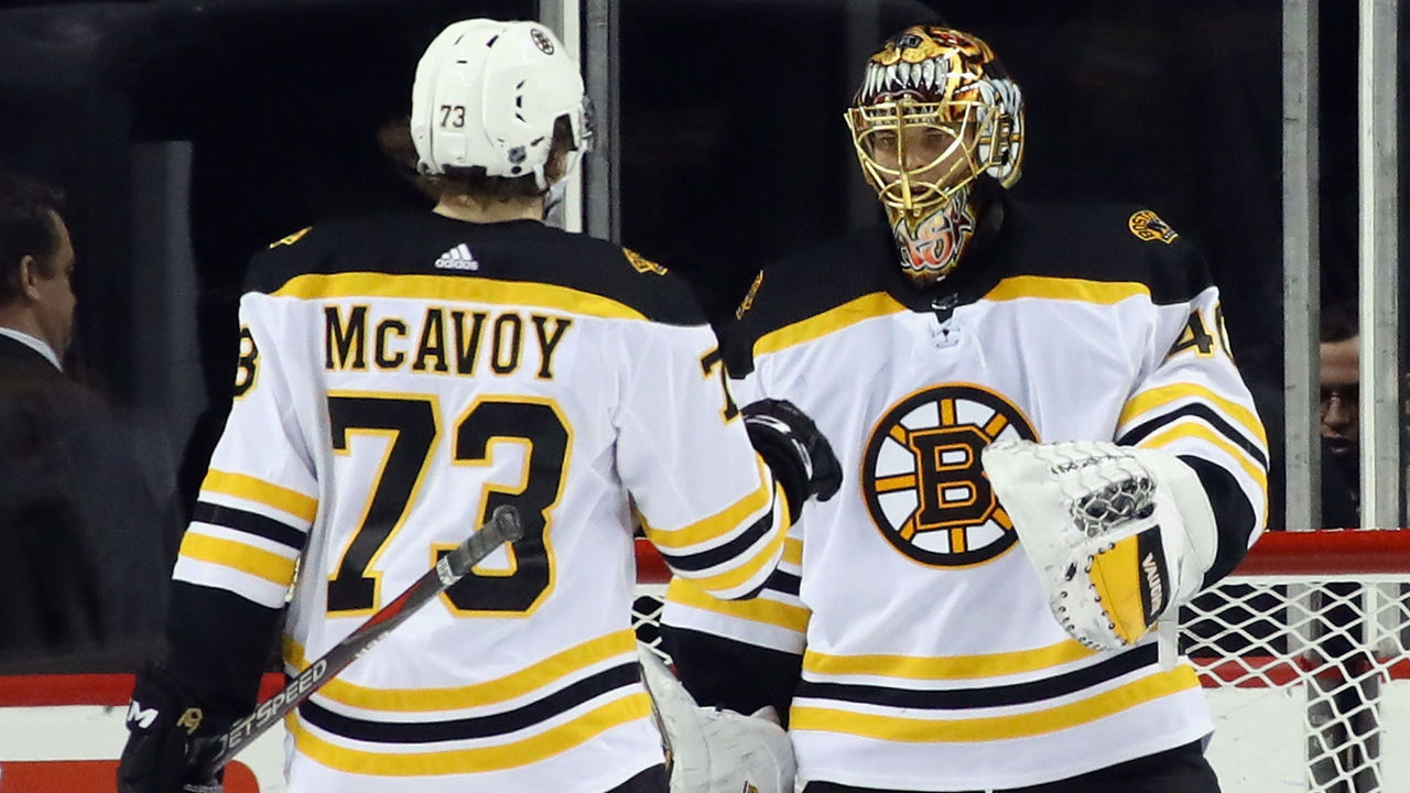 NEW YORK, NY - JANUARY 02: Charlie McAvoy #73 and Tuukka Rask #40 of the Boston Bruins celebrate a 5-1 victory over the New York Islanders at the Barclays Center on January 2, 2018 in the Brooklyn borough of New York City.