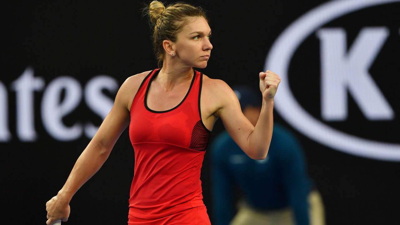 Romania's Simona Halep reacts against Canada's Eugenie Bouchard during their women's singles second round match on day four of the Australian Open tennis tournament in Melbourne on January 18, 2018. / AFP PHOTO / Paul Crock / -- IMAGE RESTRICTED TO EDITORIAL USE - STRICTLY NO COMMERCIAL USE --
