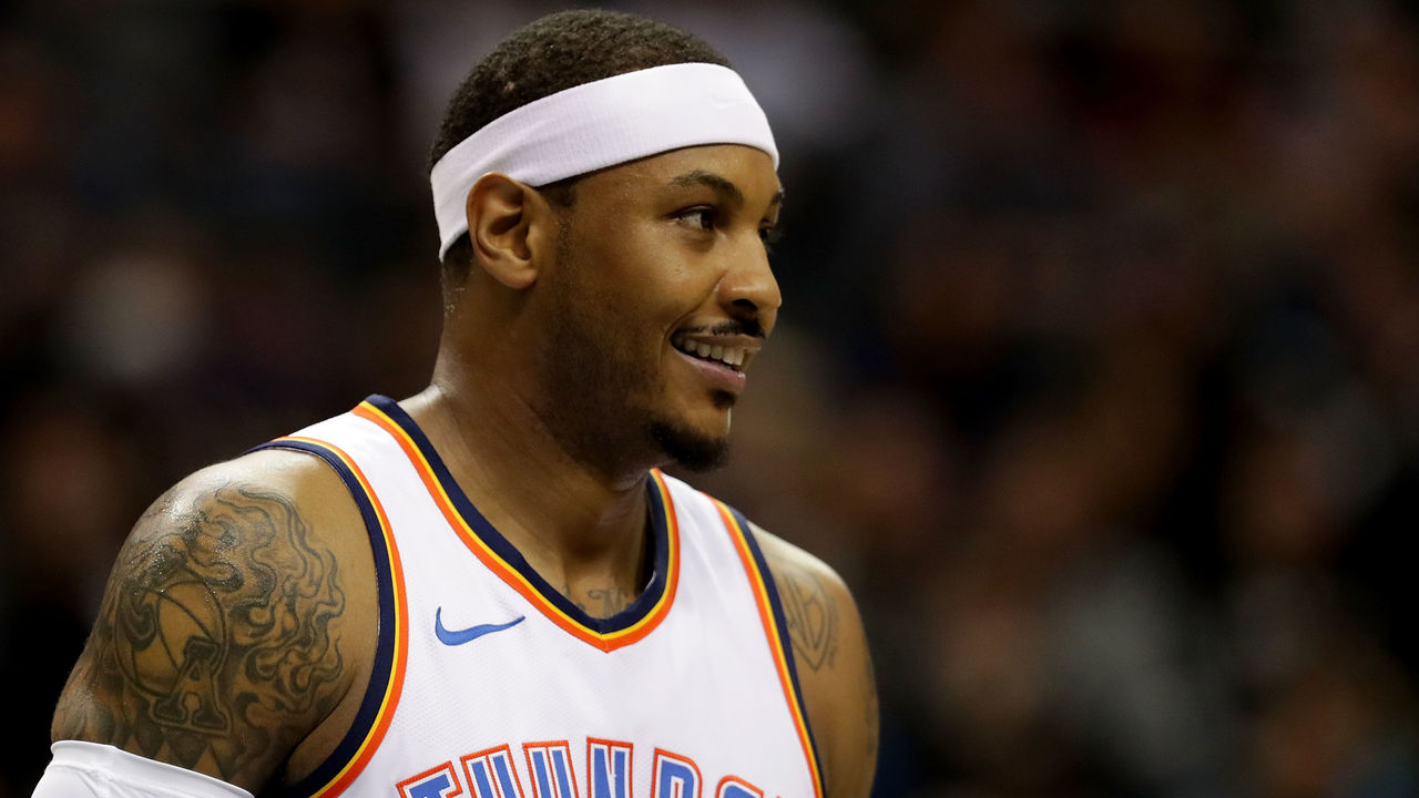 CHARLOTTE, NC - JANUARY 13: Carmelo Anthony #7 of the Oklahoma City Thunder watches on against the Charlotte Hornets during their game at Spectrum Center on January 13, 2018 in Charlotte, North Carolina.