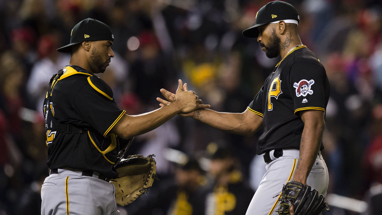 WASHINGTON, DC - SEPTEMBER 30: Elias Diaz #32 and Felipe Rivero #73 of the Pittsburgh Pirates celebrate after the Pirates defeated the Washington Nationals 4-1 at Nationals Park on September 30, 2017 in Washington, DC.