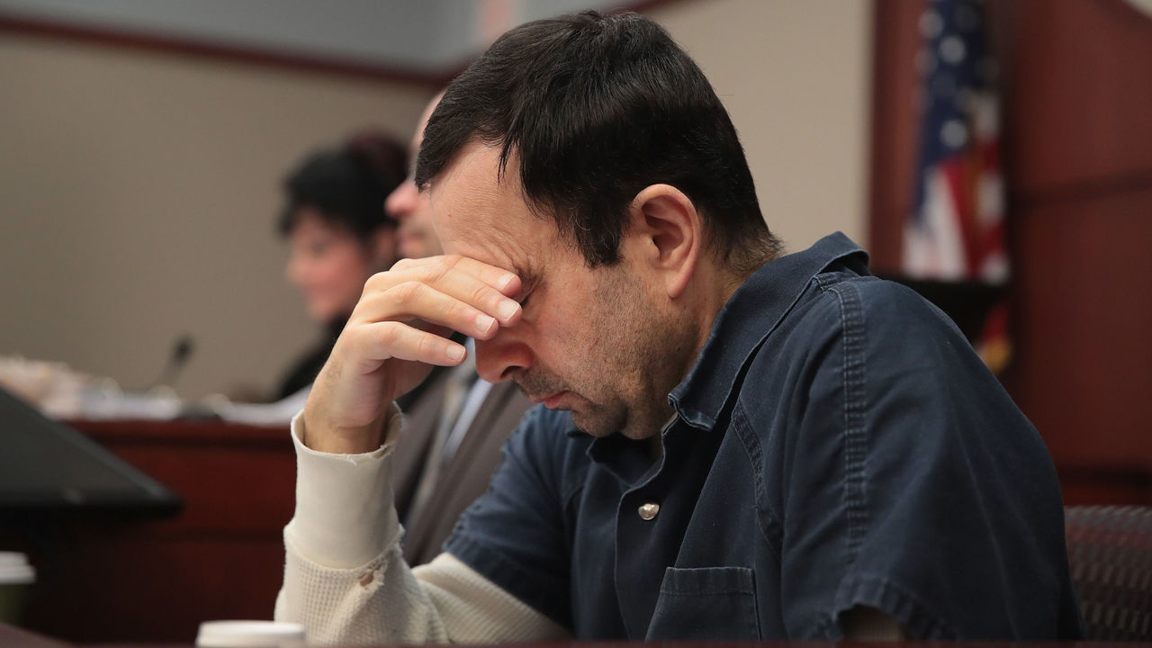 LANSING, MI - JANUARY 17: Larry Nassar listens to victim impact statements during his sentencing hearing after being accused of molesting more than 100 girls while he was a physician for USA Gymnastics and Michigan State University where he had his sports-medicine practice on January 17, 2018 in Lansing, Michigan. Nassar has pleaded guilty in Ingham County, Michigan, to sexually assaulting seven girls, but the judge is allowing all his accusers to speak. Nassar is currently serving a 60-year sentence in federal prison for possession of child pornography.