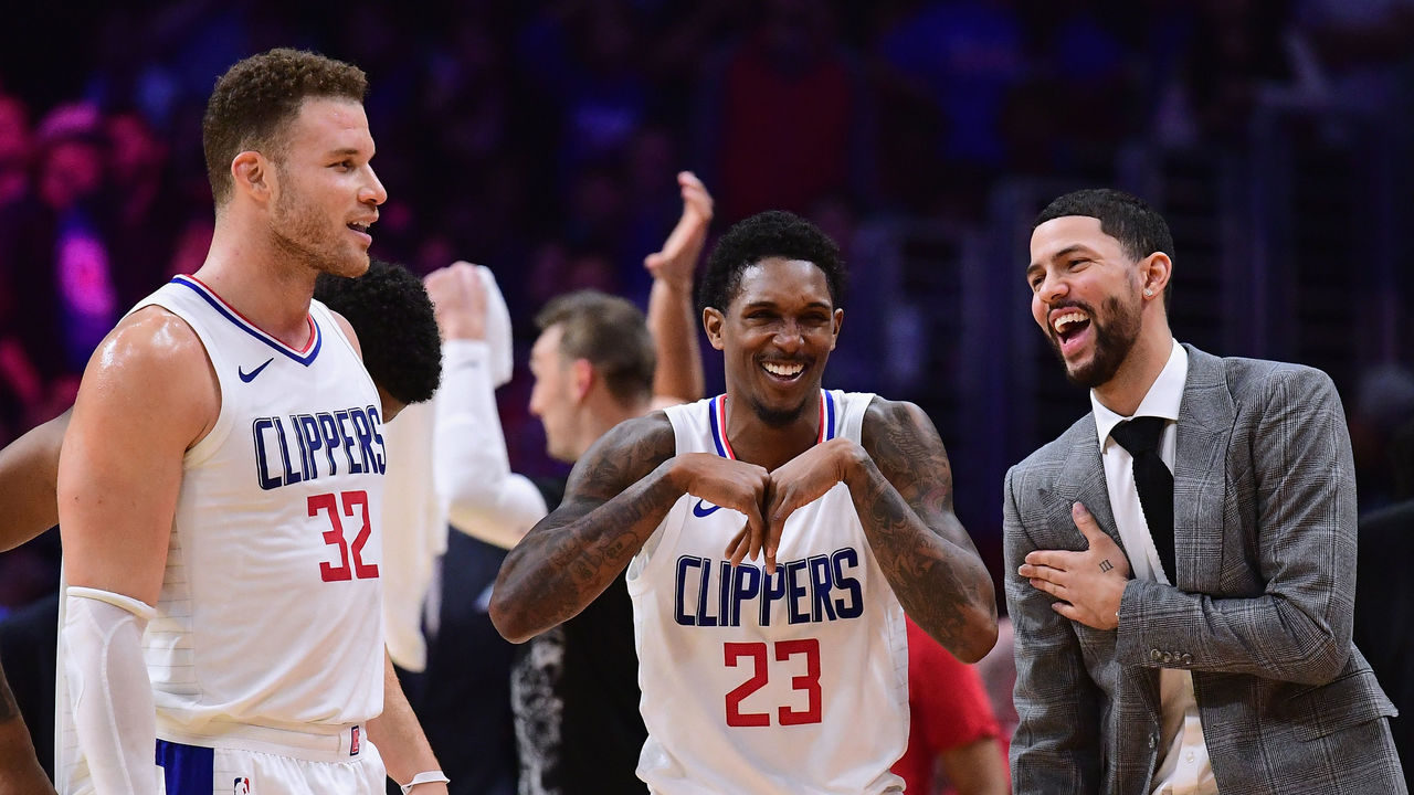 LOS ANGELES, CA - JANUARY 15: (R-L) Austin Rivers #25, Lou Williams #23 and Blake Griffin #32 of the LA Clippers laugh during a stop in play in a 113-102 Clipper win over the Houston Rockets at Staples Center on January 15, 2018 in Los Angeles, California.