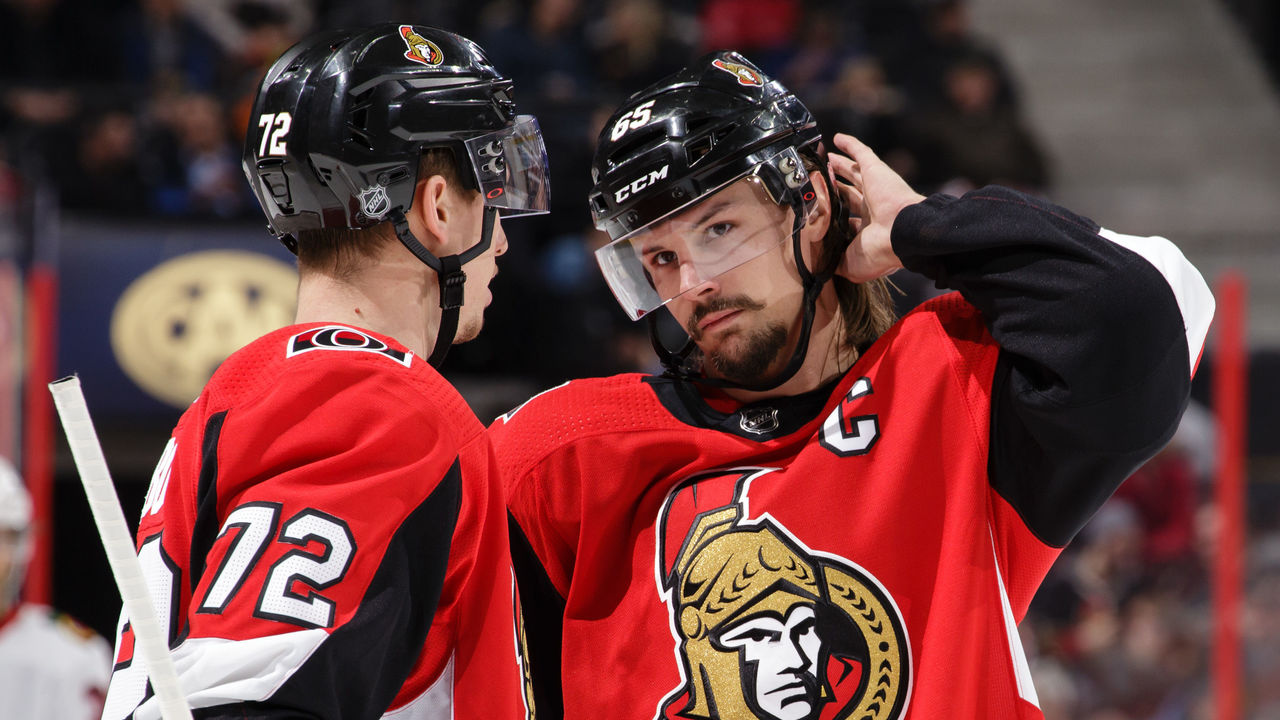 OTTAWA, ON - JANUARY 9: Teammates Thomas Chabot #72 and Erik Karlsson #65 of the Ottawa Senators chat during a stoppage in play in a game against the Chicago Blackhawks at Canadian Tire Centre on January 9, 2018 in Ottawa, Ontario, Canada.