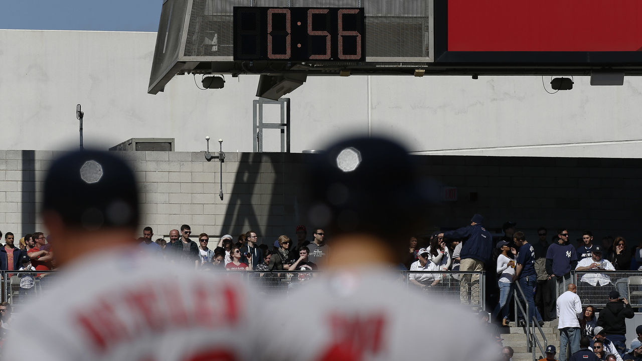 NEW YORK, NY - APRIL 11: A clock used to time pitching changes runs in left field as the Boston Red Sox face the New York Yankees at Yankee Stadium on April 11, 2015 in the Bronx borough of New York City.