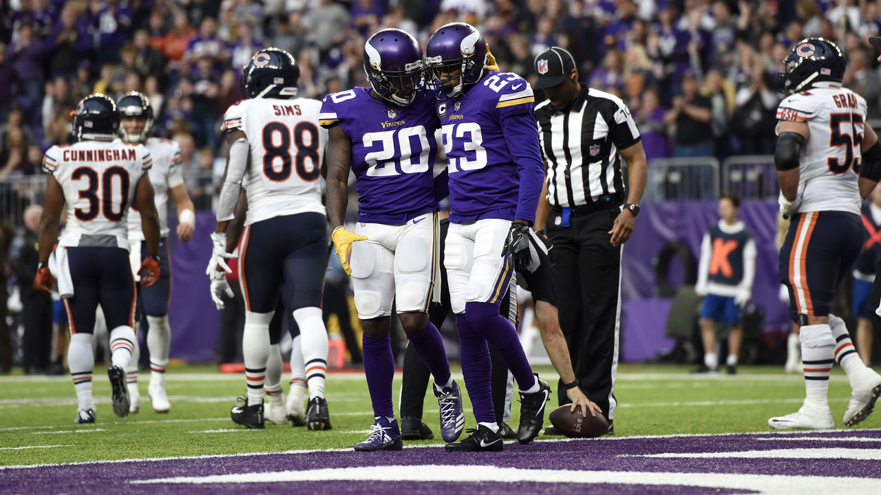 MINNEAPOLIS, MN - DECEMBER 31: Mackensie Alexander #20 of the Minnesota Vikings celebrates with teammate Terence Newman #23 turning over the Chicago Bears in the fourth quarter of the game on December 31, 2017 at U.S. Bank Stadium in Minneapolis, Minnesota.