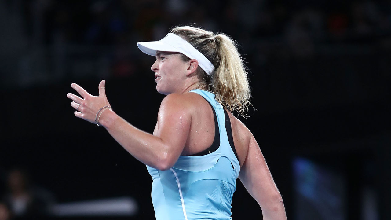 MELBOURNE, AUSTRALIA - JANUARY 15: CoCo Vandeweghe of the United States reacts in her first round match against Timea Babos of Hungary on day one of the 2018 Australian Open at Melbourne Park on January 15, 2018 in Melbourne, Australia.