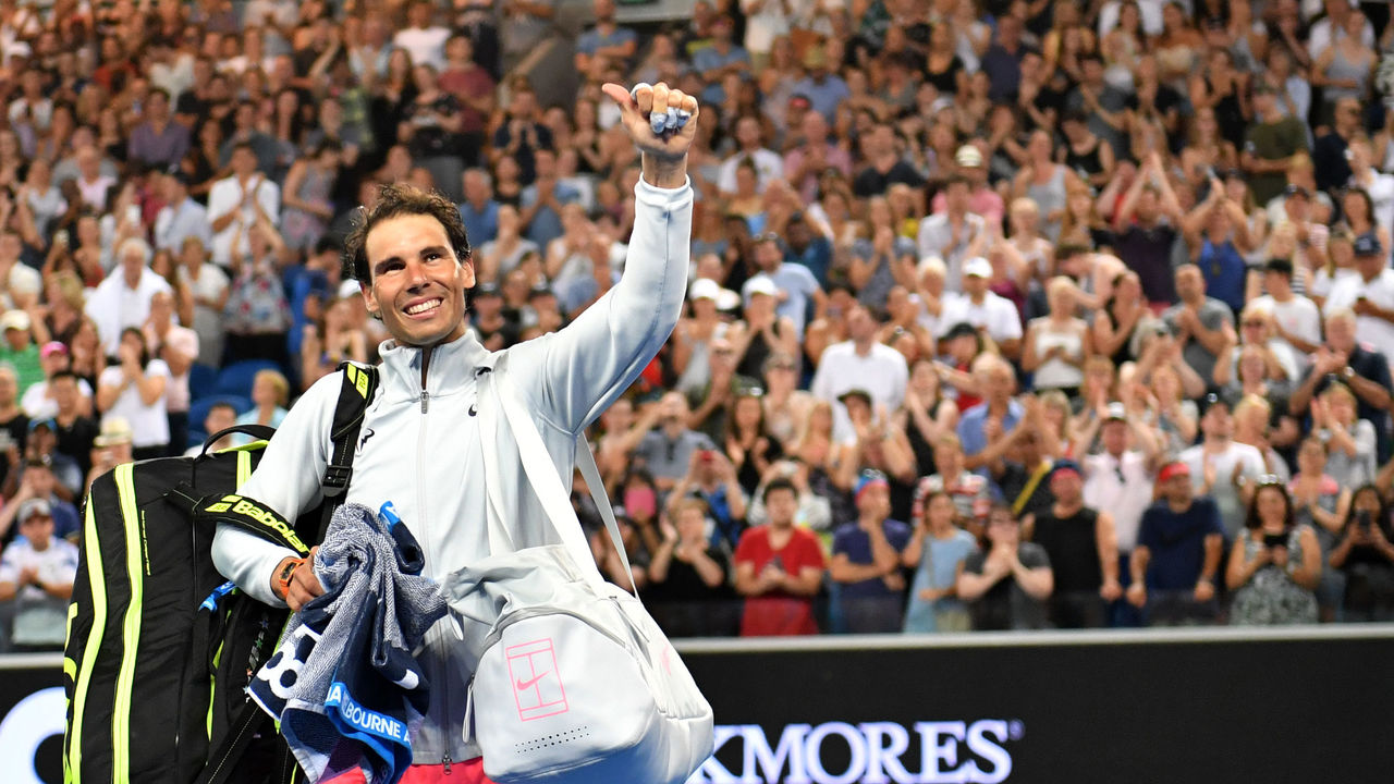 Spain's Rafael Nadal waves to the crowd after beating Bosnia's Damir Dzumhur in their men's singles third round match on day five of the Australian Open tennis tournament in Melbourne on January 19, 2018. / AFP PHOTO / SAEED KHAN / -- IMAGE RESTRICTED TO EDITORIAL USE - STRICTLY NO COMMERCIAL USE --