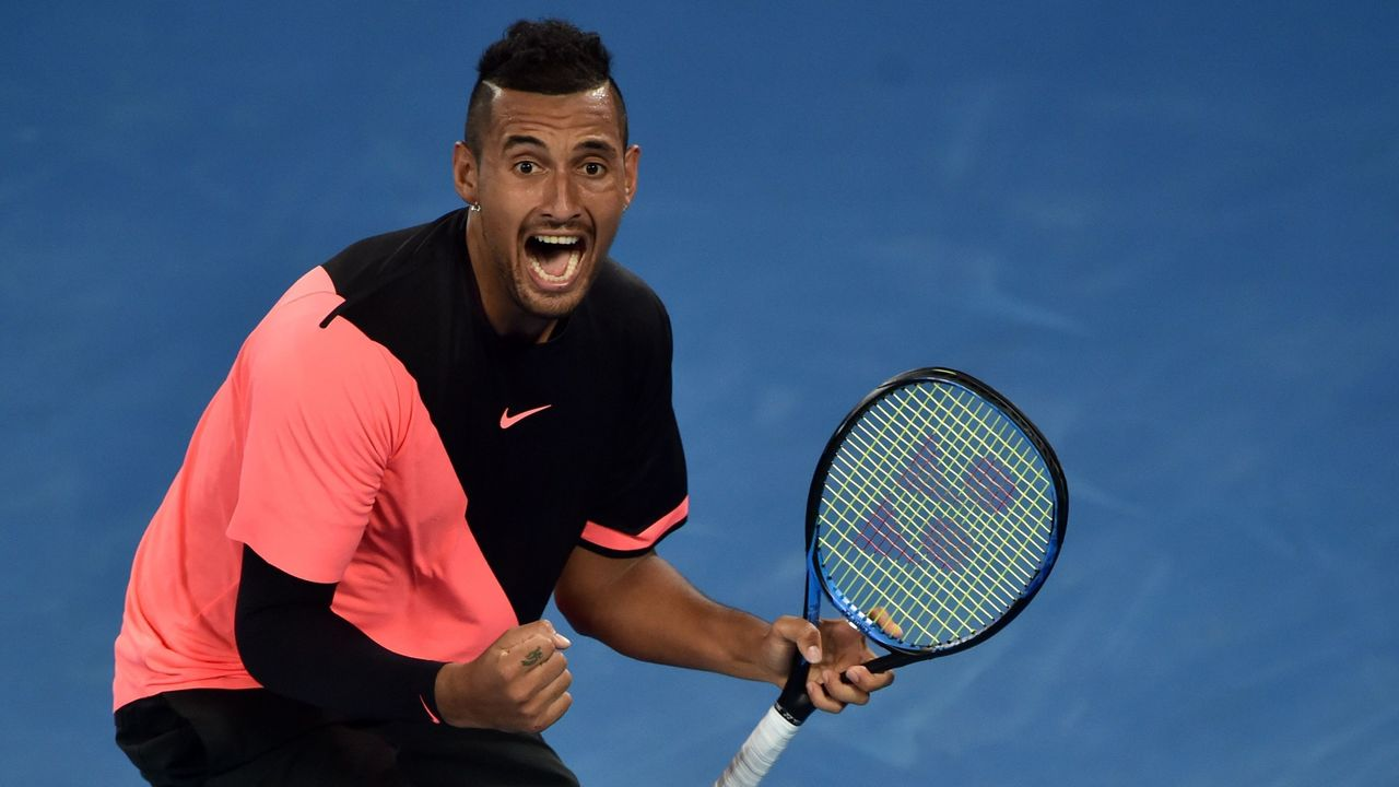 Australia's Nick Kyrgios celebrates after victory over France's Jo-Wilfried Tsonga during their men's singles third round match on day five of the Australian Open tennis tournament in Melbourne on January 19, 2018. / AFP PHOTO / PETER PARKS / -- IMAGE RESTRICTED TO EDITORIAL USE - STRICTLY NO COMMERCIAL USE --