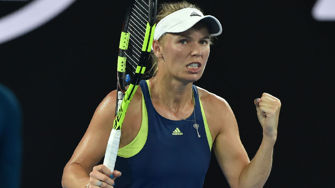 Denmark's Caroline Wozniacki celebrates beating Netherland's Kiki Bertens during their women's singles third round match on day five of the Australian Open tennis tournament in Melbourne early January 20, 2018. / AFP PHOTO / PETER PARKS / -- IMAGE RESTRICTED TO EDITORIAL USE - STRICTLY NO COMMERCIAL USE --