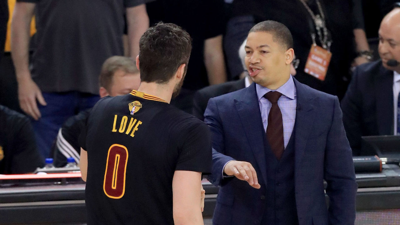 OAKLAND, CA - JUNE 12: Tyronn Lue of the Cleveland Cavaliers speaks with Kevin Love #0 after being called for a foul against the Golden State Warriors during the first quarter in Game 5 of the 2017 NBA Finals at ORACLE Arena on June 12, 2017 in Oakland, California.