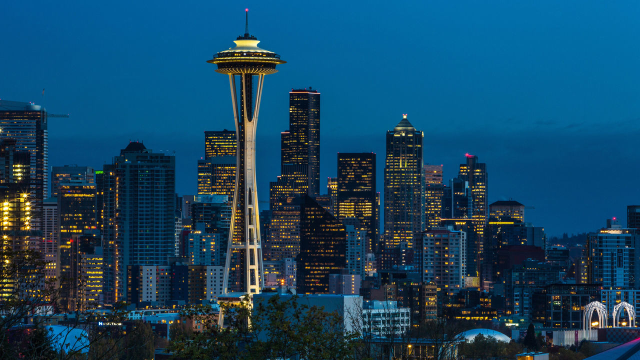 SEATTLE, WA - NOVEMBER 4: The sun sets on the Space Needle and downtown skyline as viewed at dusk on November 4, 2015, in Seattle, Washington. Seattle, located in King County, is the largest city in the Pacific Northwest, and is experiencing an economic boom as a result of its European and Asian global business connections.