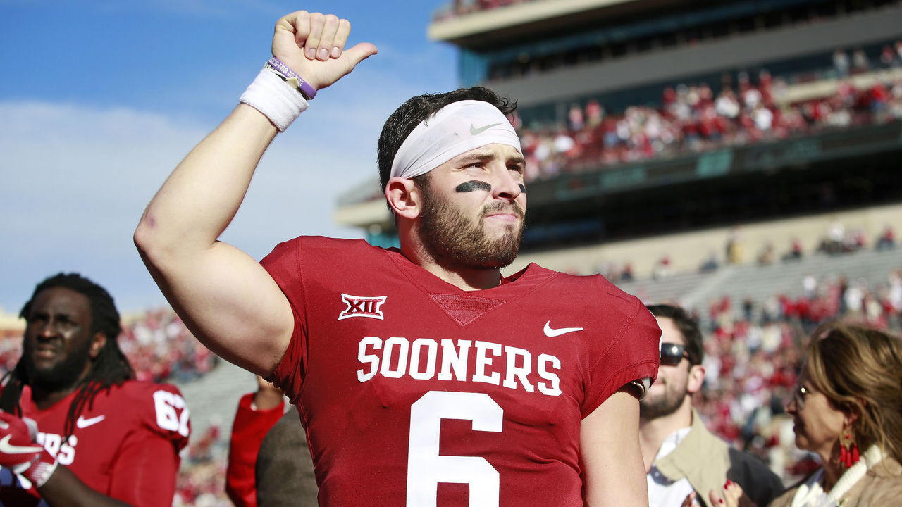 NORMAN, OK - NOVEMBER 25: Quarterback Baker Mayfield #6 of the Oklahoma Sooners gestures to the crowd after Senior Day announcements before the game against the West Virginia Mountaineers at Gaylord Family Oklahoma Memorial Stadium on November 25, 2017 in Norman, Oklahoma. Oklahoma defeated West Virginia 59-31.
