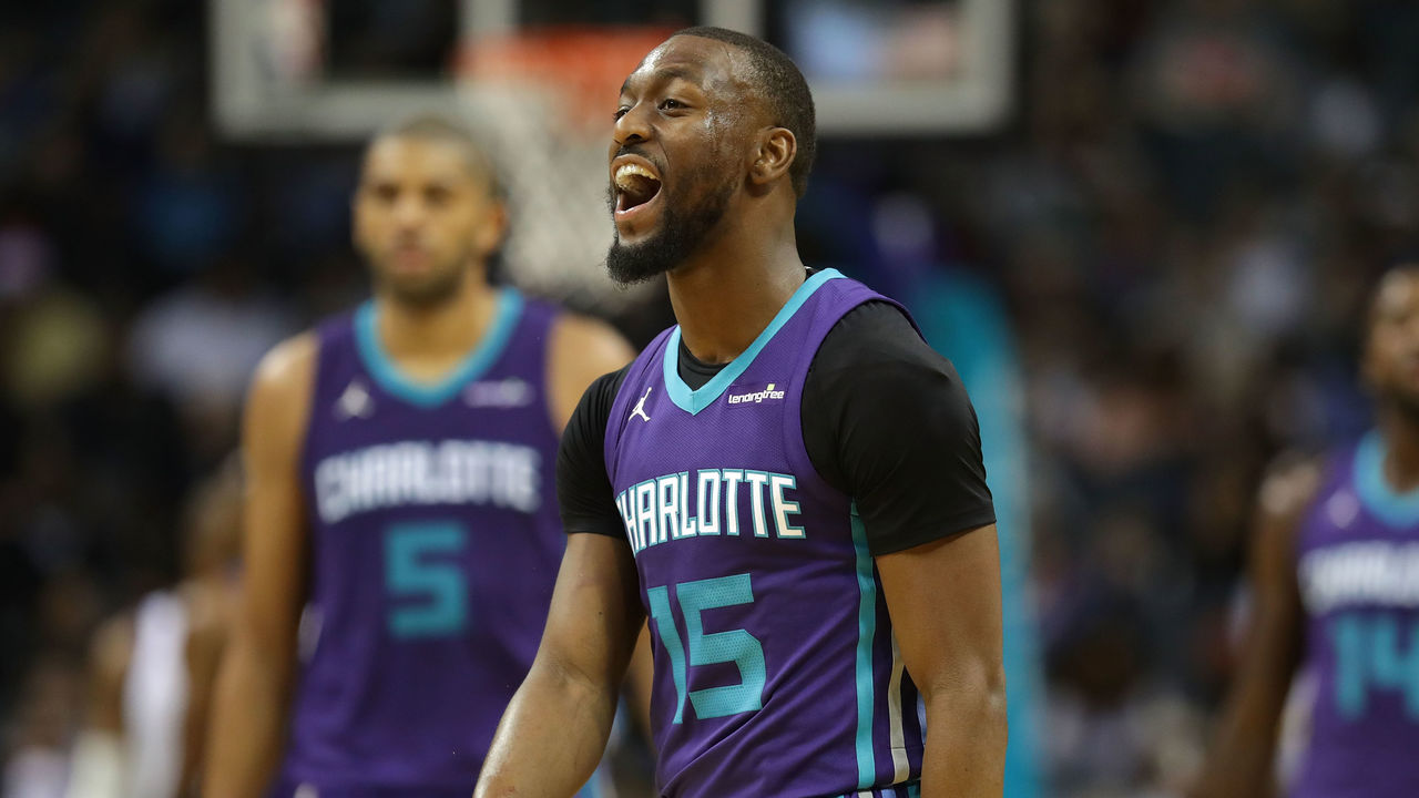 CHARLOTTE, NC - DECEMBER 06: Kemba Walker #15 of the Charlotte Hornets reacts after a play against the Golden State Warriors during their game at Spectrum Center on December 6, 2017 in Charlotte, North Carolina.