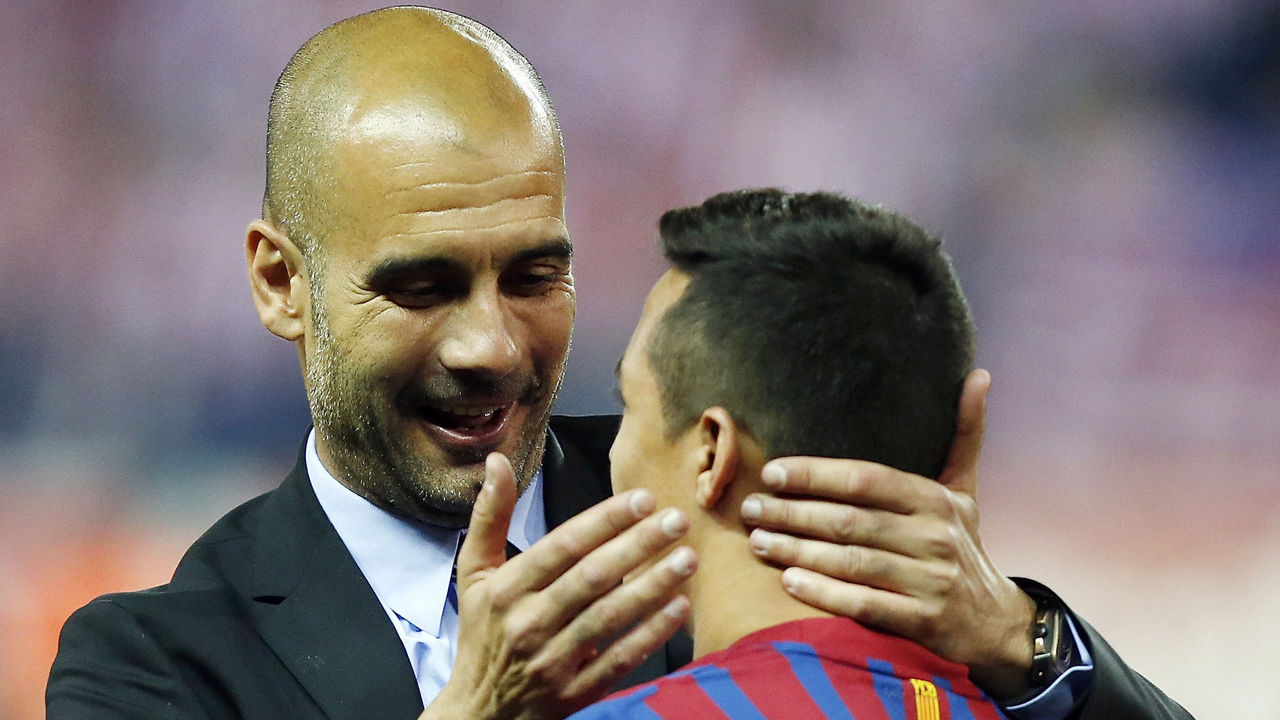 MADRID, SPAIN - MAY 25: Head coach Pepe Guardiola (L) of Barcelona embraces Alexis Sanchez after their victory in the Copa del Rey Final match between Athletic Bilbao and Barcelona at Vicente Calderon Stadium on May 25, 2012 in Madrid, Spain.