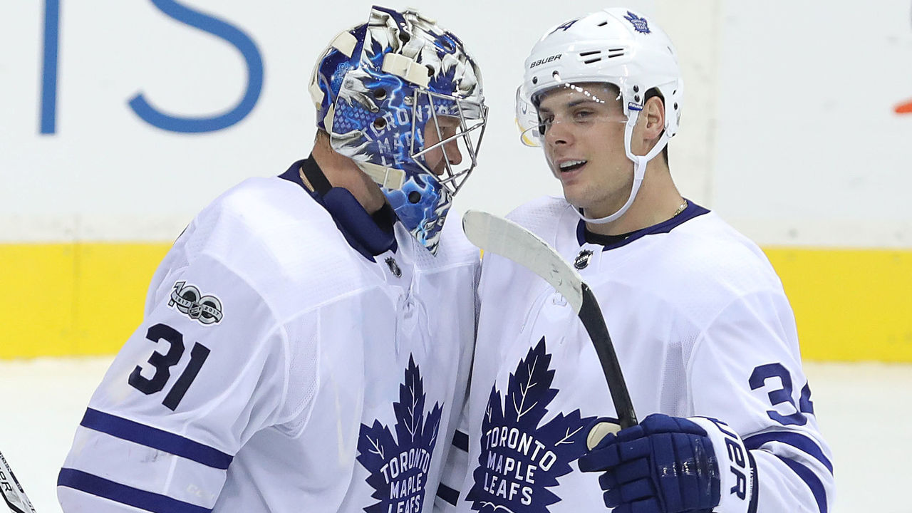 WINNIPEG, MANITOBA - OCTOBER 4: Forward Auston Matthews #34 of the Toronto Maple Leafs congratulates goaltender Frederik Andersen #31 after defeating the Winnipeg Jets during NHL action on October 4, 2017 at the Bell MTS Place in Winnipeg, Manitoba.