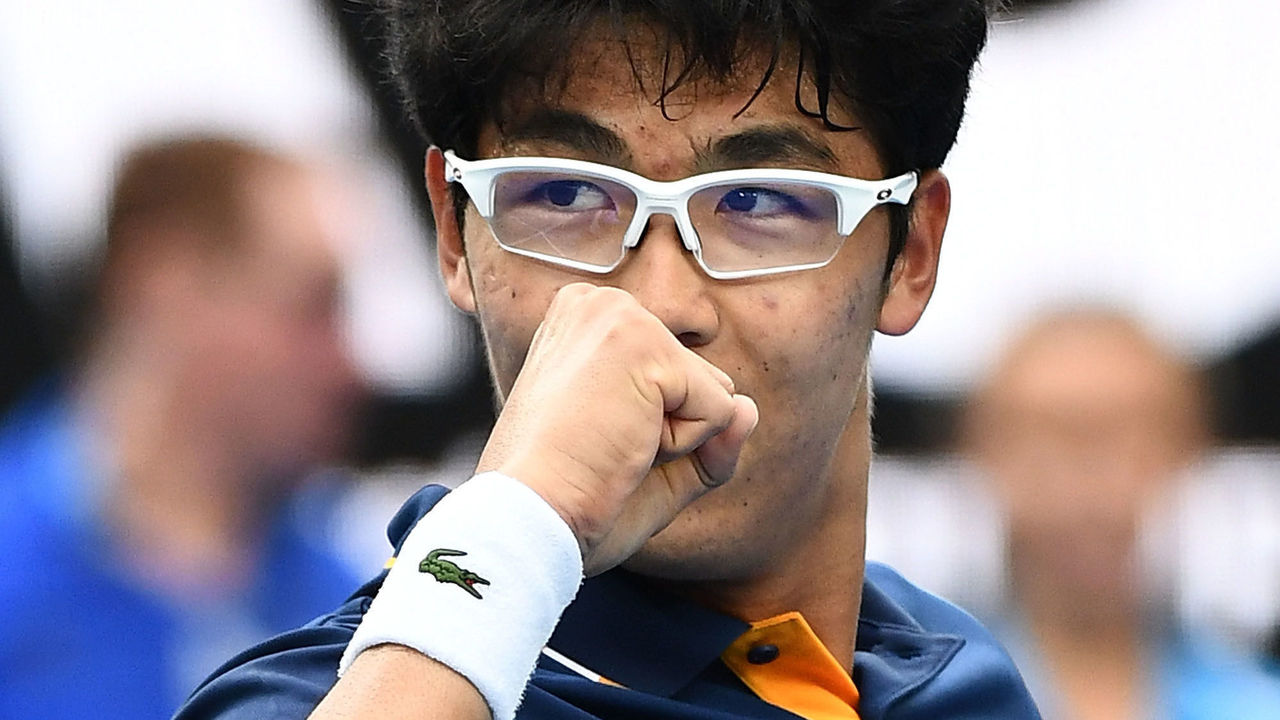MELBOURNE, AUSTRALIA - JANUARY 20: Hyeon Chung of Korea celebrates after winning his third round match against Alexander Zverev of Germany on day six of the 2018 Australian Open at Melbourne Park on January 20, 2018 in Melbourne, Australia.
