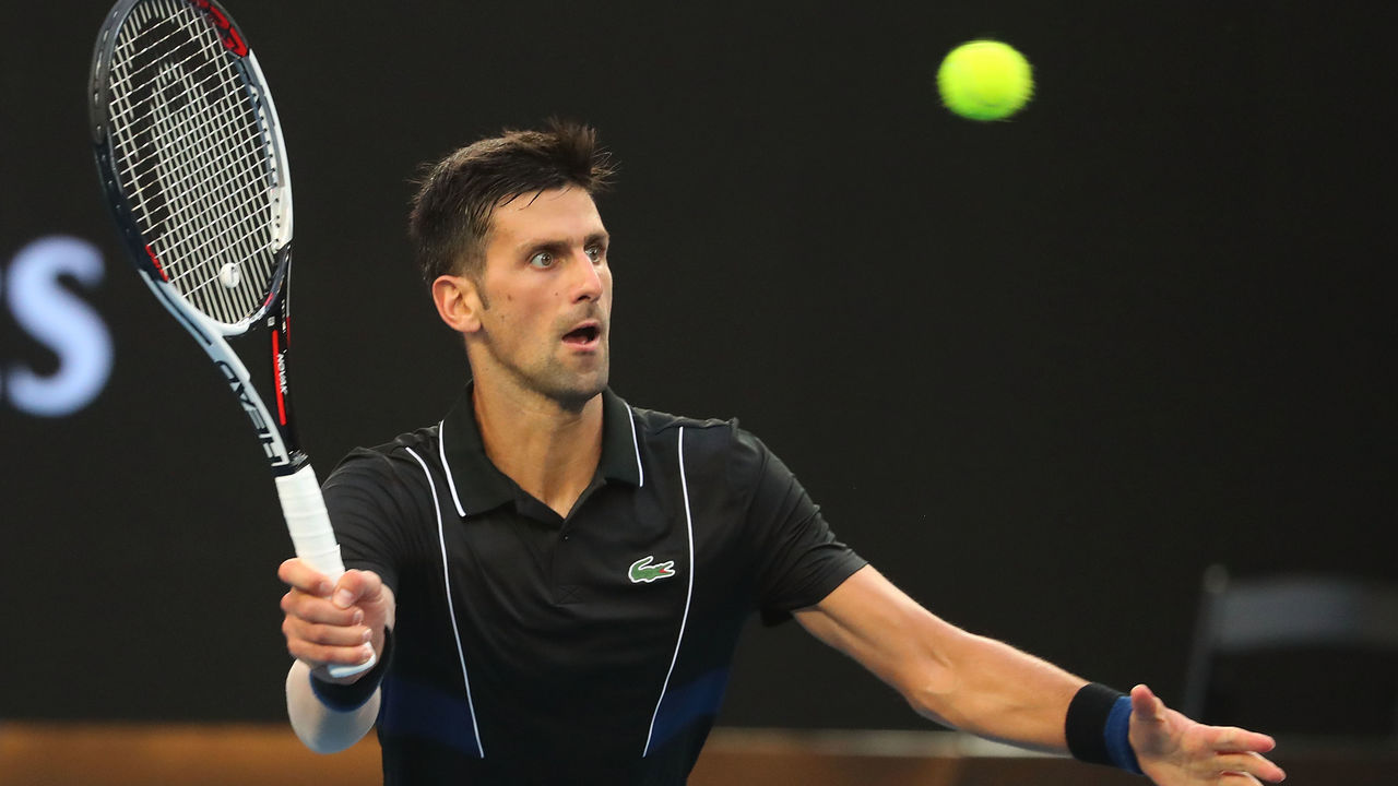 MELBOURNE, AUSTRALIA - JANUARY 20: Novak Djokovic of Serbia plays a forehand in his third round match against Albert Ramos-Vinolas of Spain on day six of the 2018 Australian Open at Melbourne Park on January 20, 2018 in Melbourne, Australia.