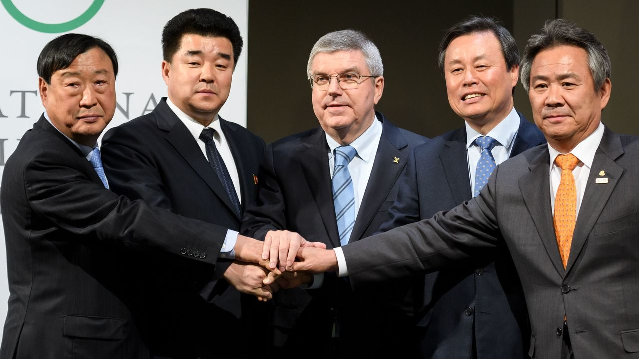 (From L) PyeongChang 2018 Olympics (POCOG) President Lee Hee-beom, North Korea's Sports Minister and Olympic Committee president Kim Il Guk, International Olympic Committee (IOC) President Thomas Bach, South Korean Minister of Culture, Sports and Tourism Do Jong-hwan and South Korea's National Olympic Committee President Lee Kee-heung join their hands as they pose during a signing ceremony at the Olympic Museum on January 20, 2018 in Lausanne. North Korea will send 22 athletes to next month's Winter Games in the South, the International Olympic Committee said on January 18, also confirming that the two nations will march together at the opening ceremony. / AFP PHOTO / Fabrice COFFRINI