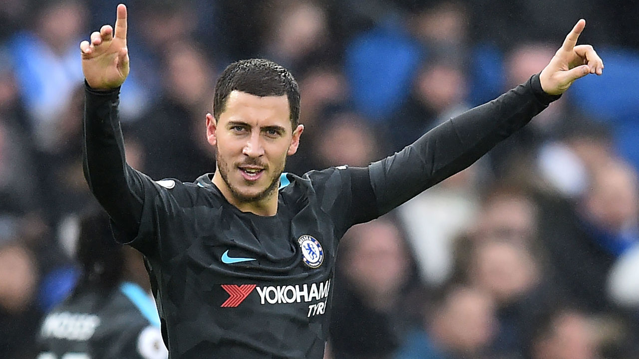 Chelsea's Belgian midfielder Eden Hazard celebrates after scoring their third goal during the English Premier League football match between Brighton and Hove Albion and Chelsea at the American Express Community Stadium in Brighton, southern England on January 20, 2018. / AFP PHOTO / Glyn KIRK /