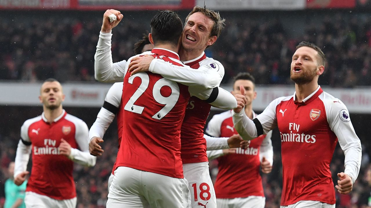 Arsenal's Spanish defender Nacho Monreal (C) celebrates after scoring with Arsenal's Swiss midfielder Granit Xhaka during the English Premier League football match between Arsenal and Crystal Palace at the Emirates Stadium in London on January 20, 2018. / AFP PHOTO / Ben STANSALL /