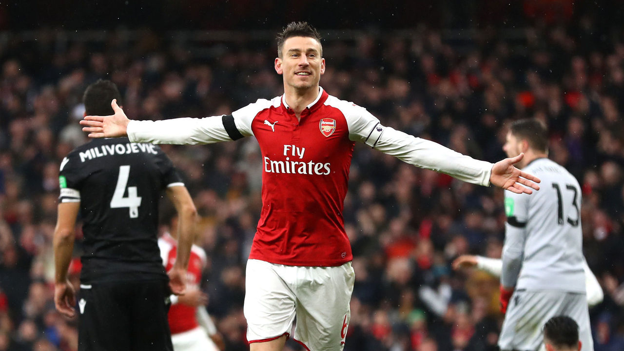 LONDON, ENGLAND - JANUARY 20: Laurent Koscielny of Arsenal celebrates after scoring his sides third goal during the Premier League match between Arsenal and Crystal Palace at Emirates Stadium on January 20, 2018 in London, England.